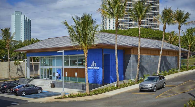 Exterior photo of Bank of Hawaii at Pearlridge showing parking and driveway