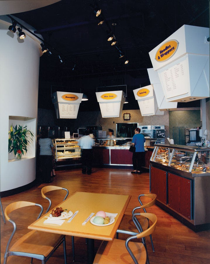 Interior photo of Chun Wah Kam Noodle Factory with menus on giant takeout boxes