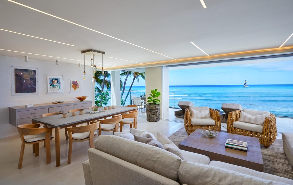 Living and dining rooms with large ocean view