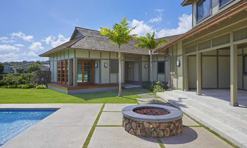 Exterior photo of house with fire pit and pool