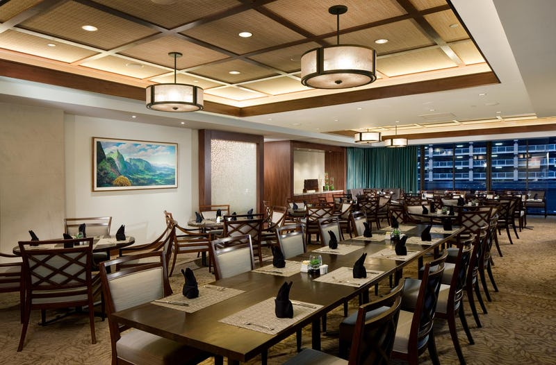 Dining room at Bank of Hawaii with table settings on each table