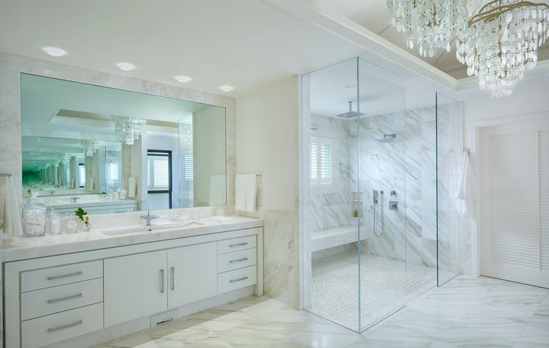 Bathroom with sink and glass walled shower
