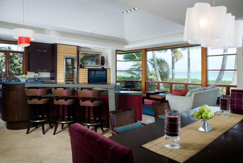 Living room featuring bar and dining table