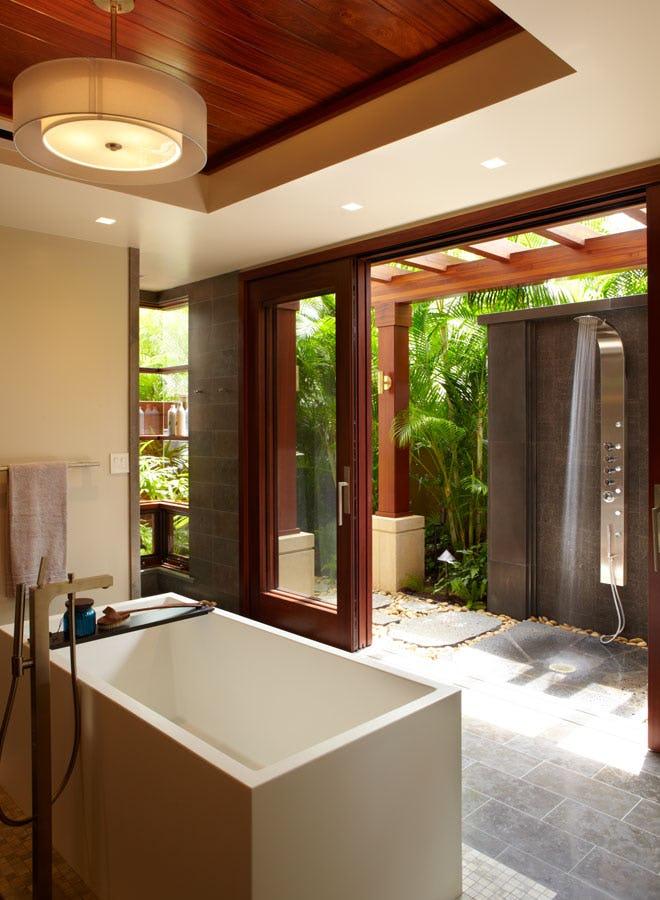 Modern outdoor shower with indoor tub