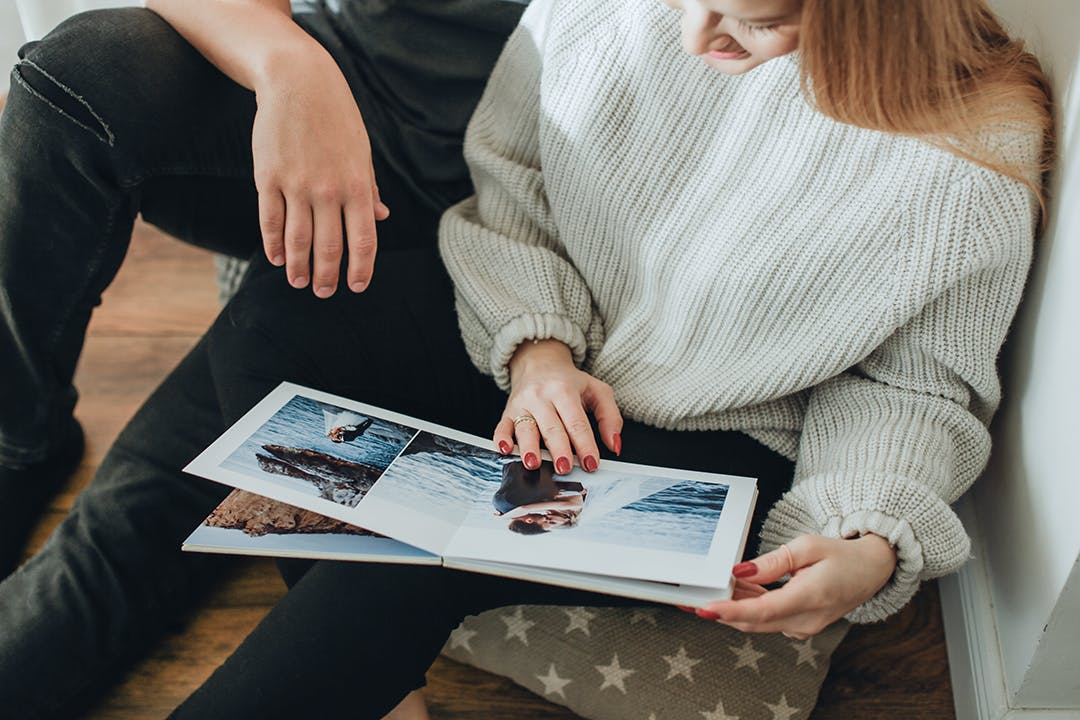 Referred photography clients looking at photo album
