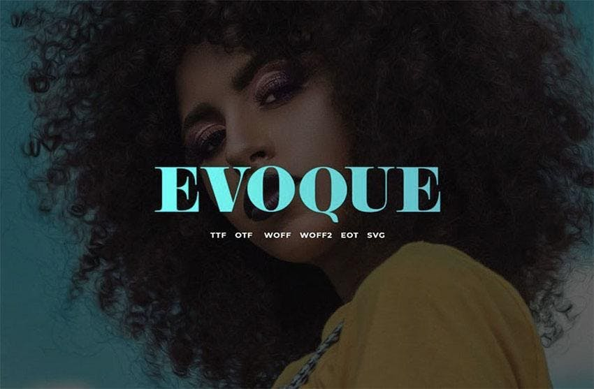 A woman with afro black hair, make up, yellow top, necklace, a tittle writing EVOQUE in teal color