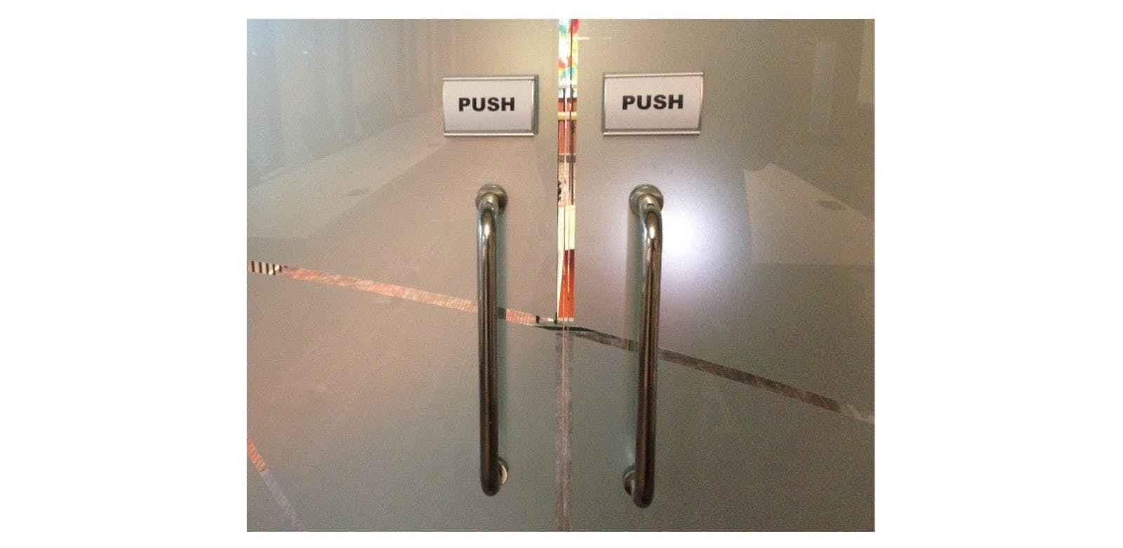 """glass doors with signs on them """"push"""""""