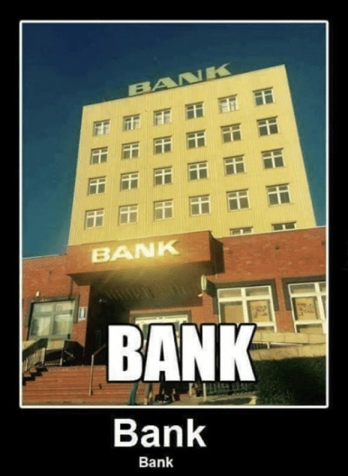 a building with a sign that says bank, blue sky, shiny letters and black background