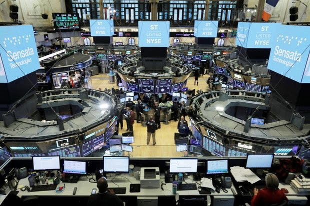 a room full of people, screens and computer screens, stock market