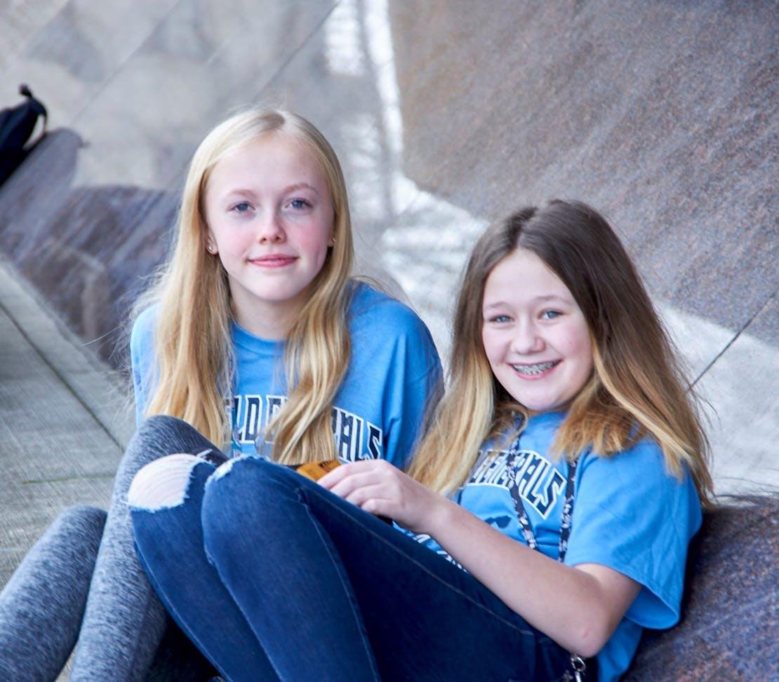 2 girls in blue shirts