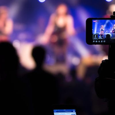 Filming a band on stage with mobile camera