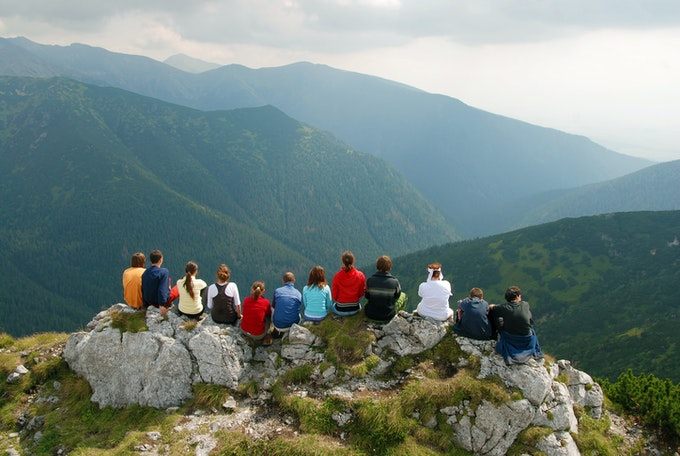 Gathering of people on a summit