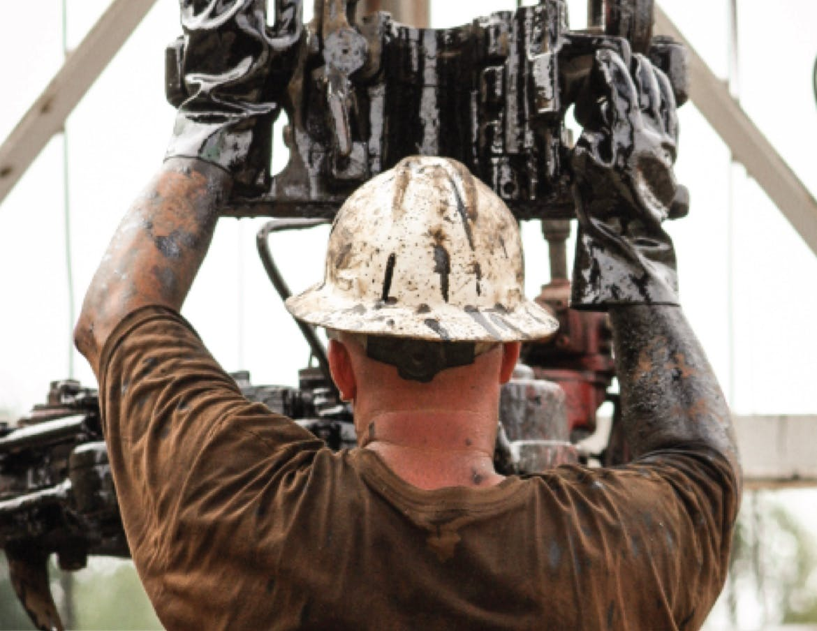 Directional driller preps the drill on an oil rig.