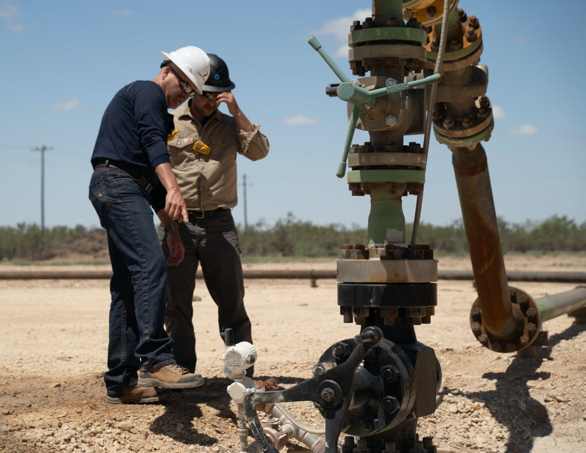 Oil & gas contractors inspect an upstream production site.