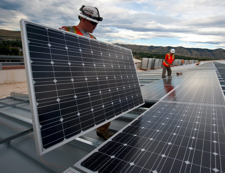 Solar technicians layout a utility-scale solar array.