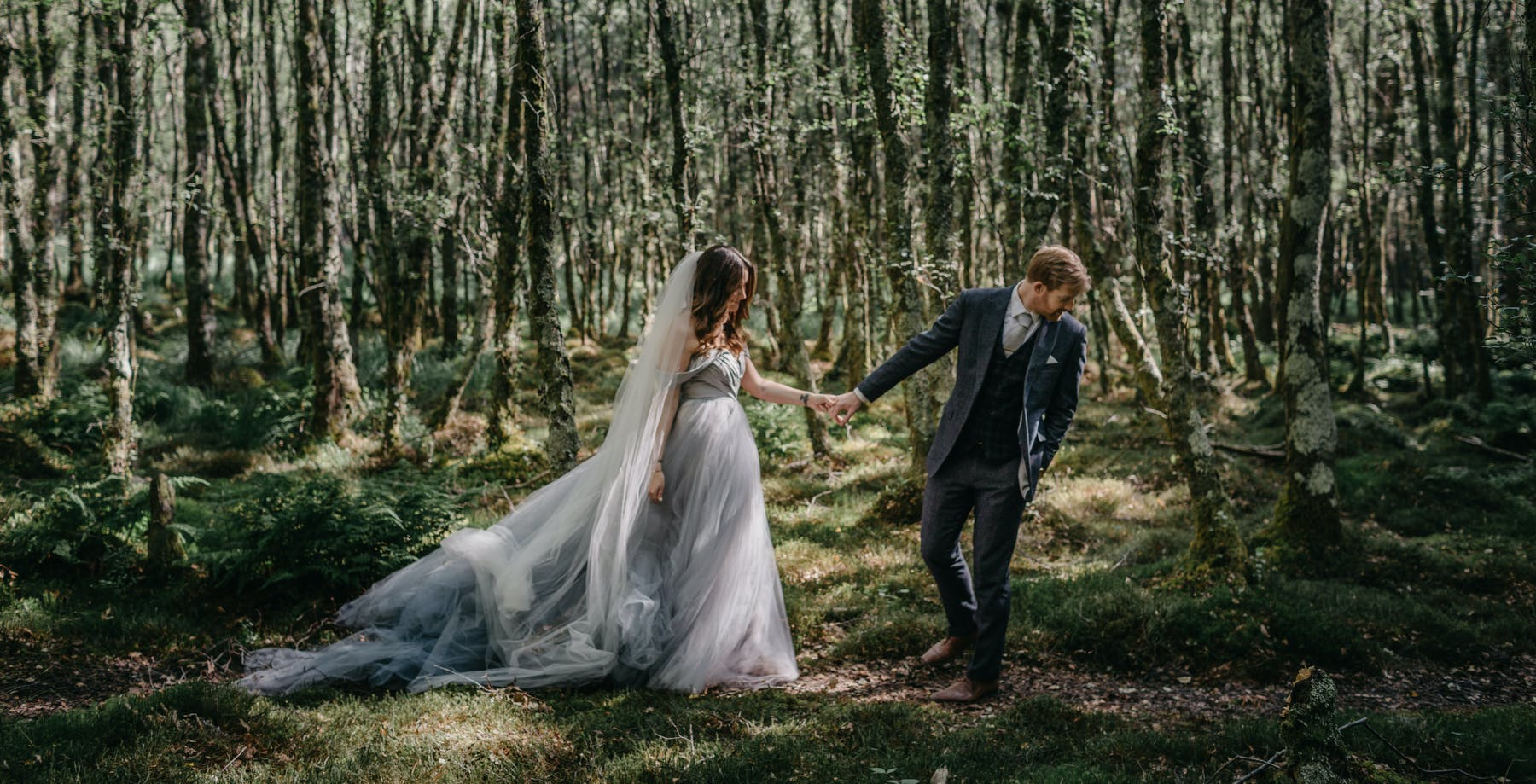 Couple in the forest of Glendalough, Ireland