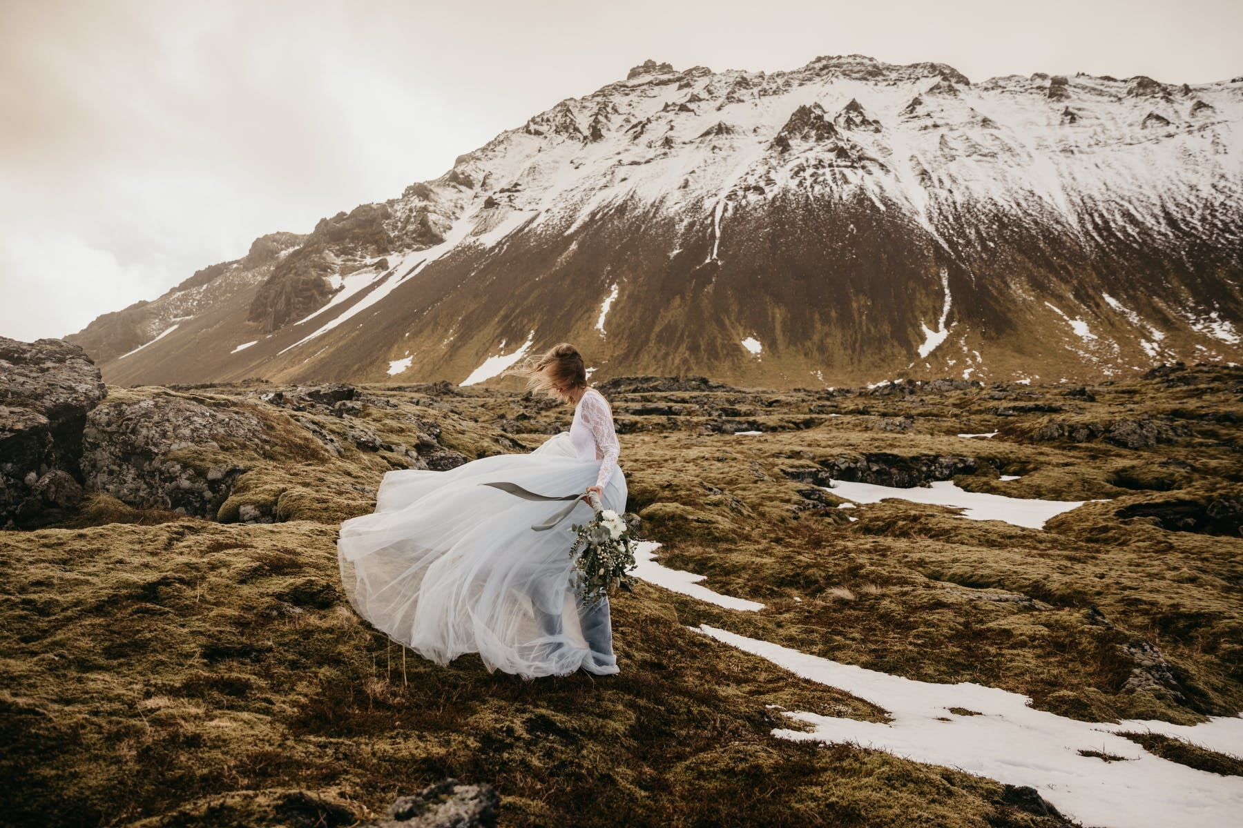Bride in front of Icelandic mountain