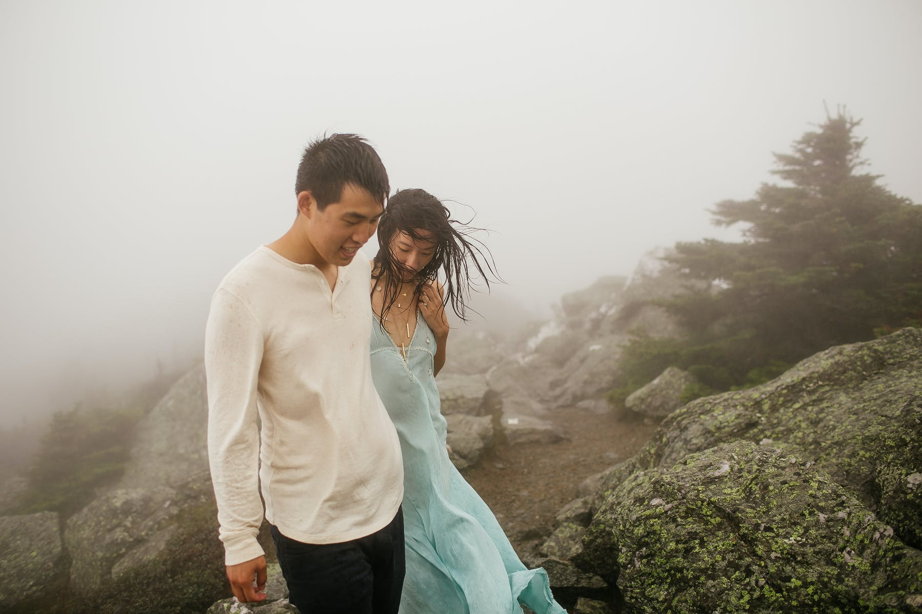 Couple walking in the fog of Mount Mansfield near Stowe, VT
