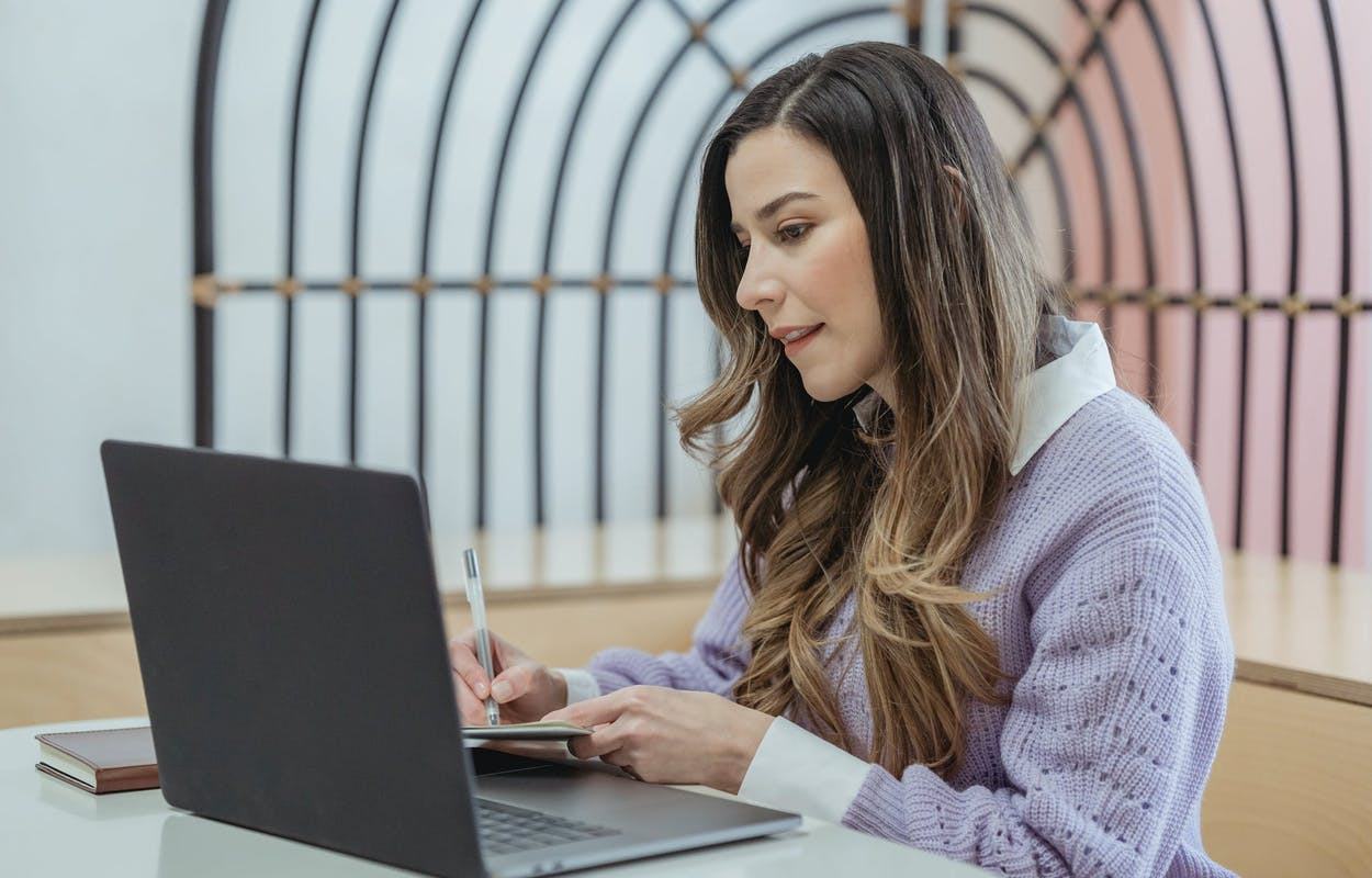Woman taking a test on a laptop