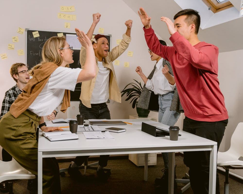 People celebrating in an office