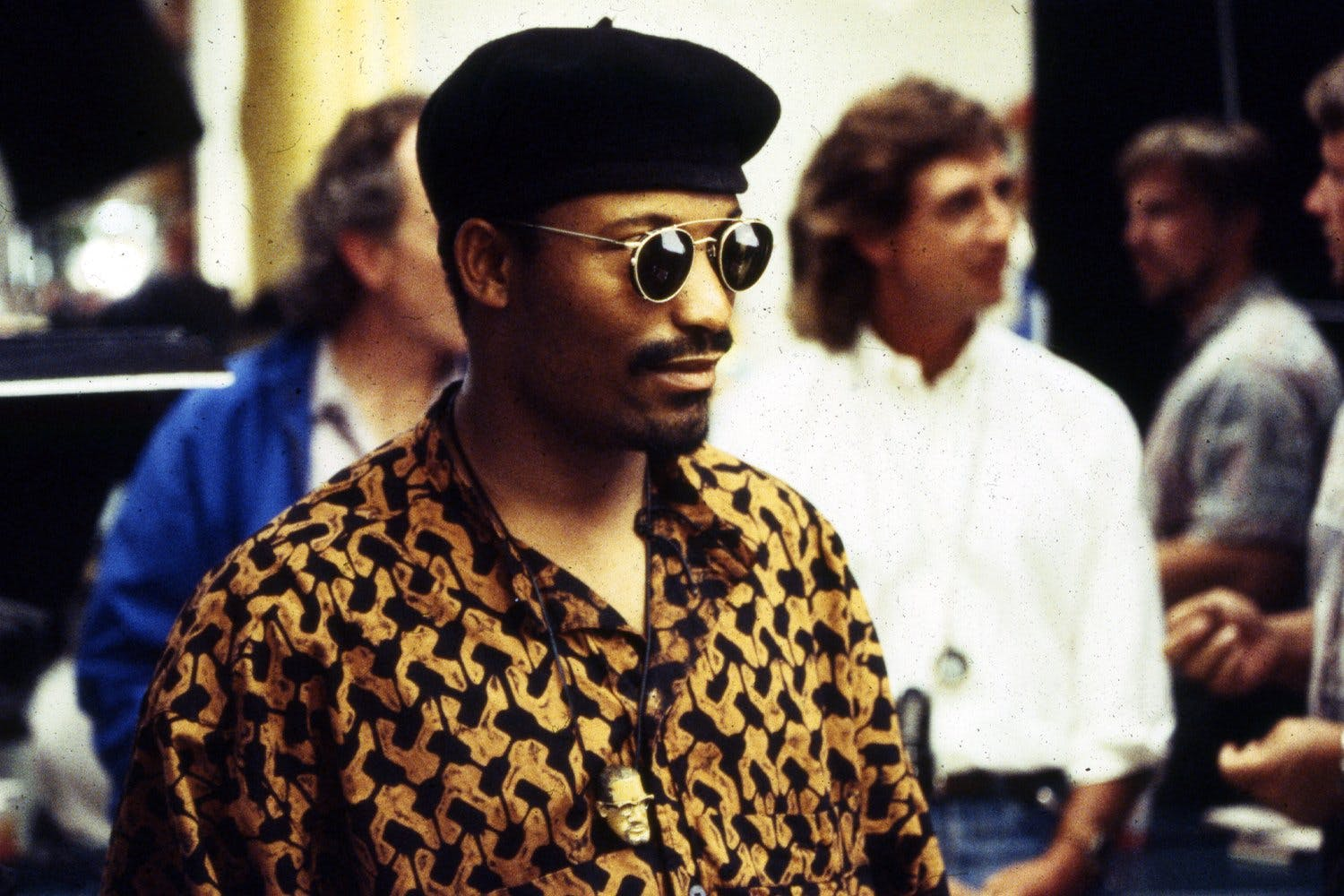 View of director John Singleton, wearing sunglasses and beret, while on the set of his movie 'Poetic Justice', Los Angeles, CA, 1993.