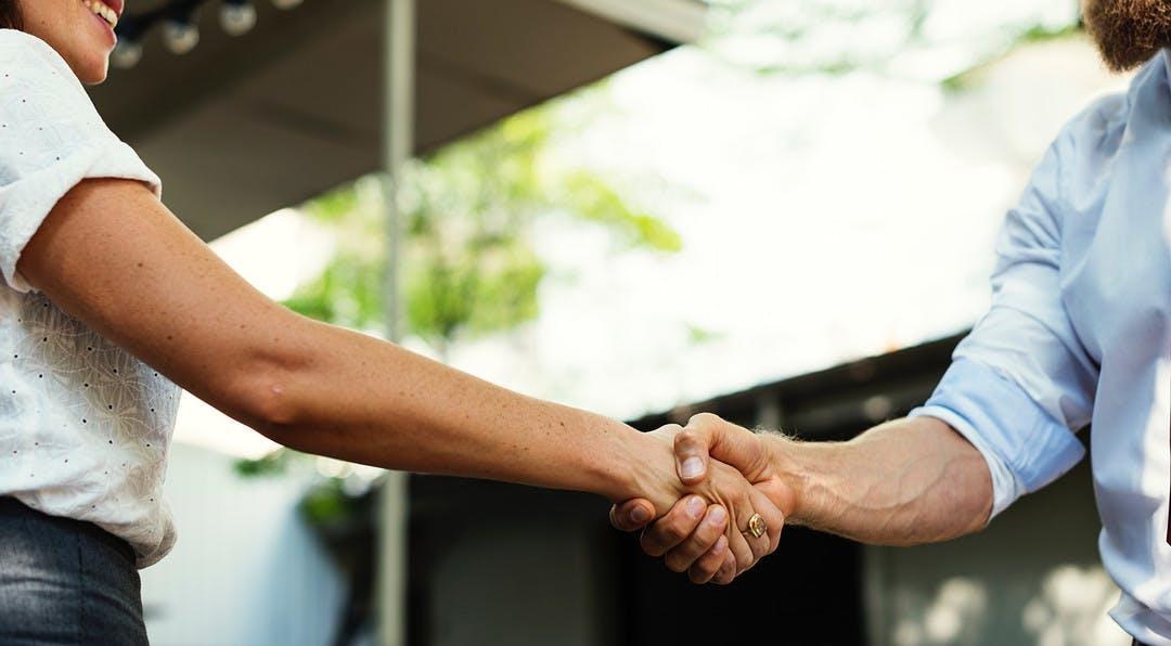 two people are shaking hands