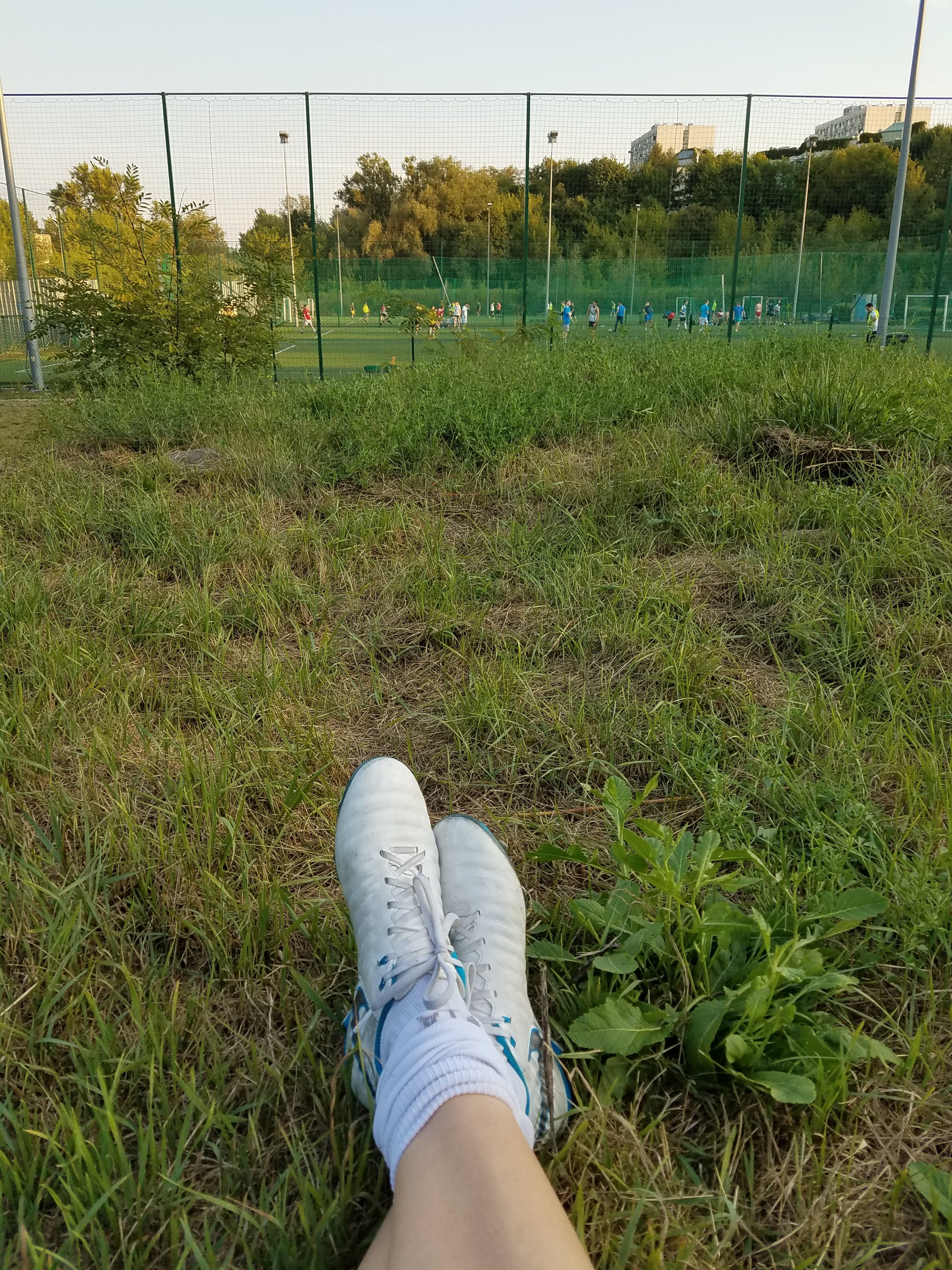 soccer cleats with field in background