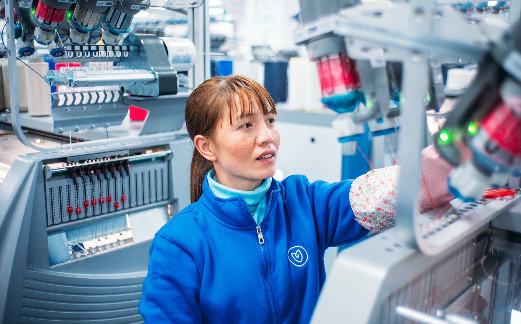 Image of China employee working and smiling in the workshop.