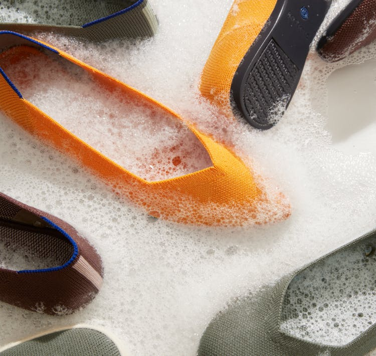 The Point in Saffron, The Flat in Thyme and The Loafer in Chocolate shown in sudsy water.