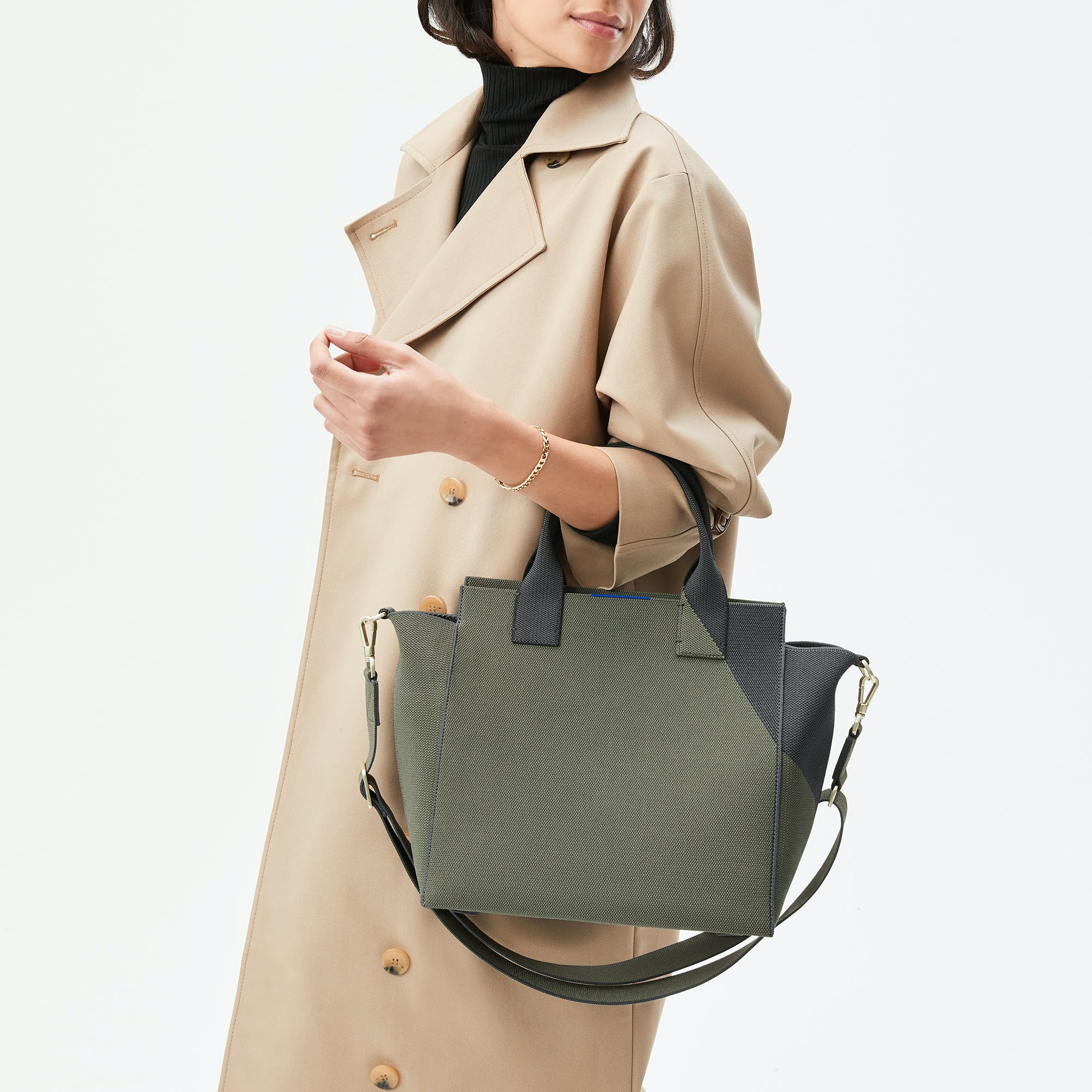 The Handbag in Sage Green shown from the front.