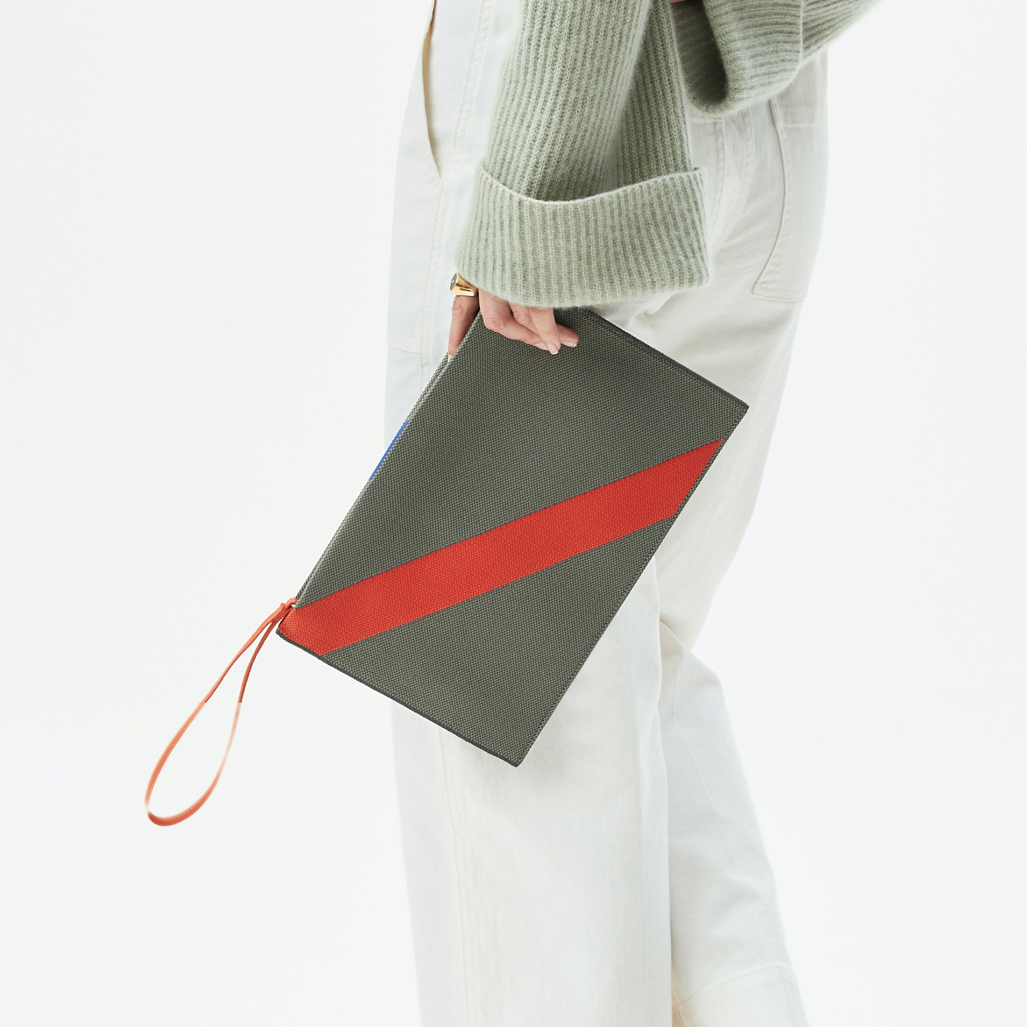 The Essential Pouch in Sage Green shown from the front.