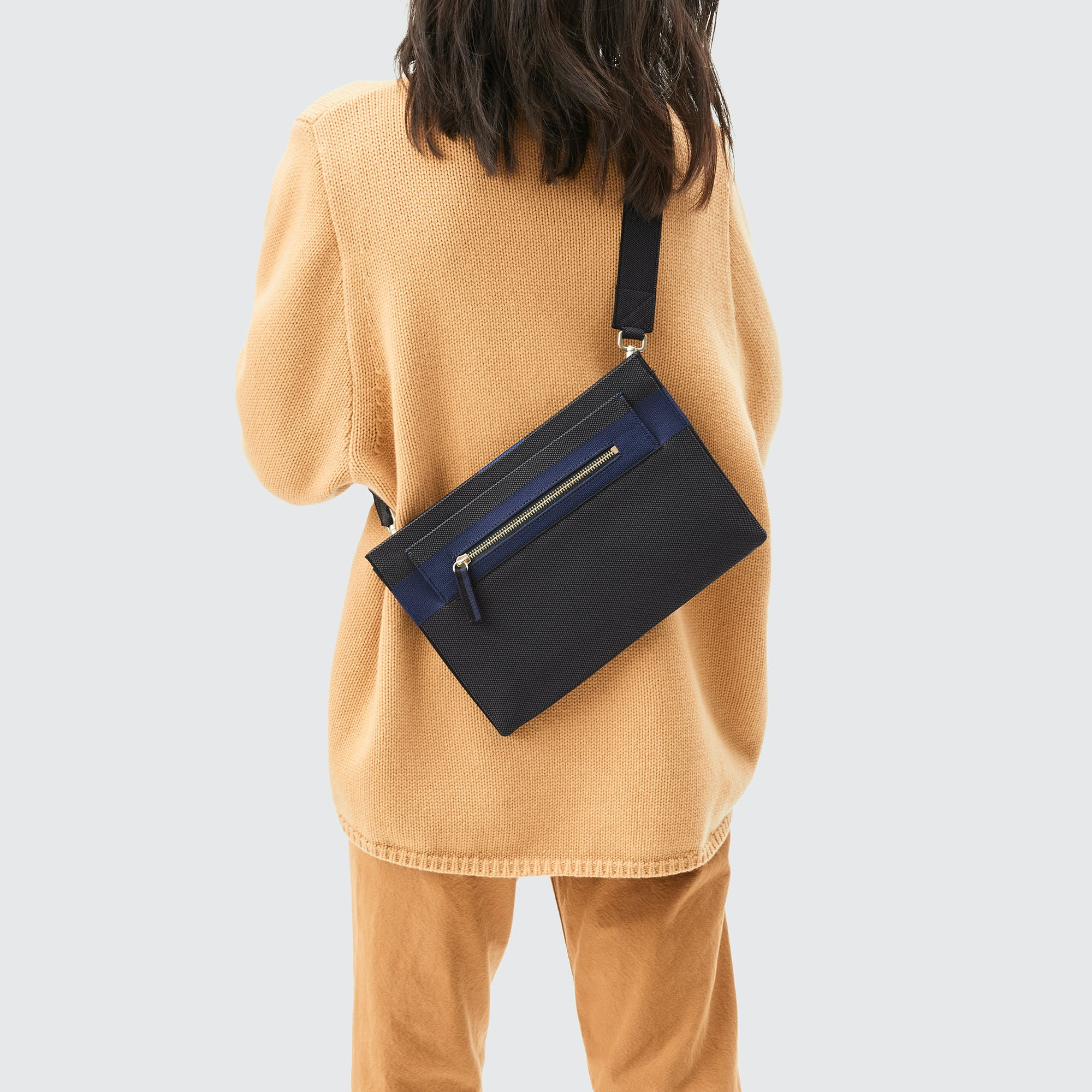 The Dual-Zip Crossbody in Slate Black shown from the front.
