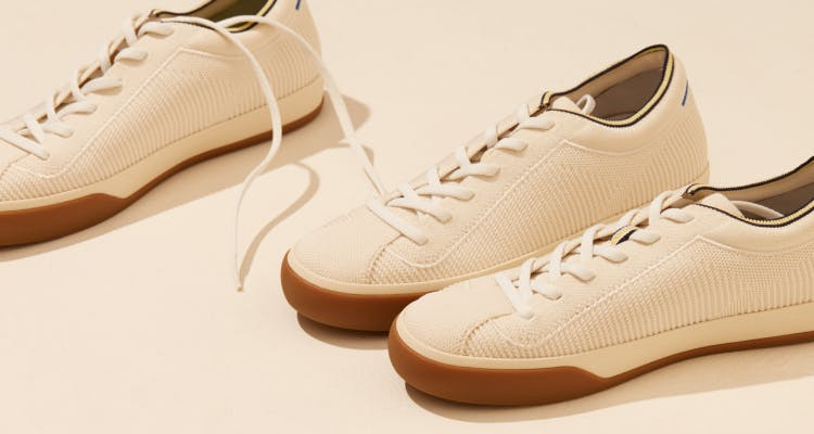 Close up of a few pairs of The Lace Up in Vanilla, shown in diagonal view.