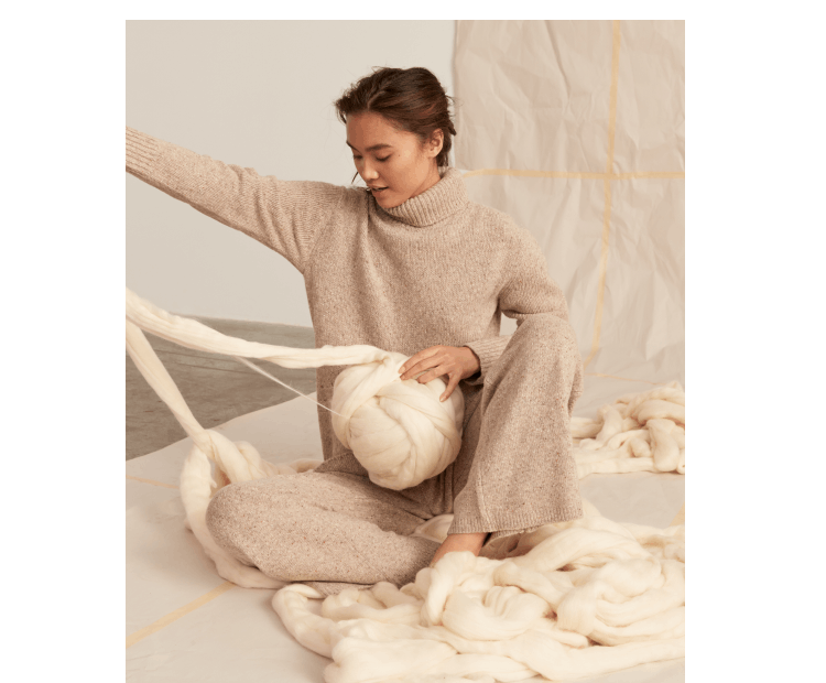 Rothy's merino wool material shown with a model.
