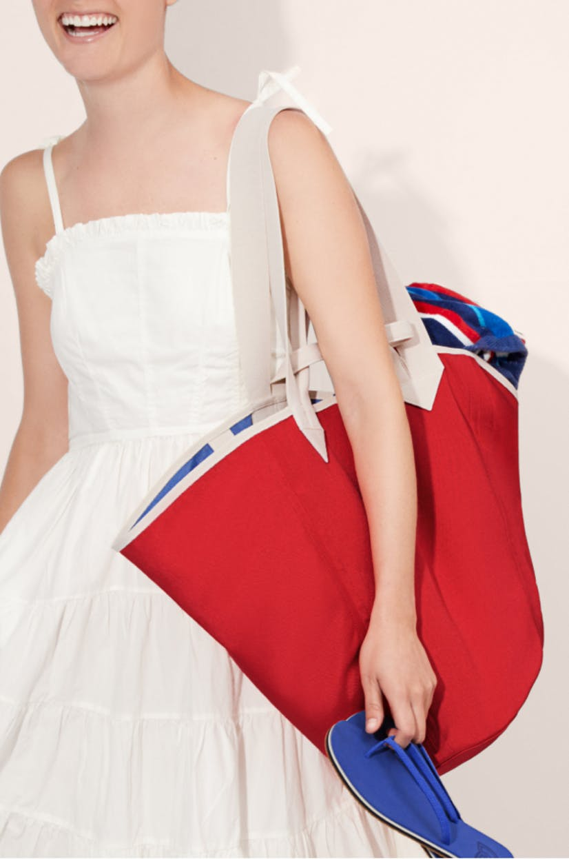 The Reversible Tote in Red & Cobalt and The Flip in Splash shown on model.