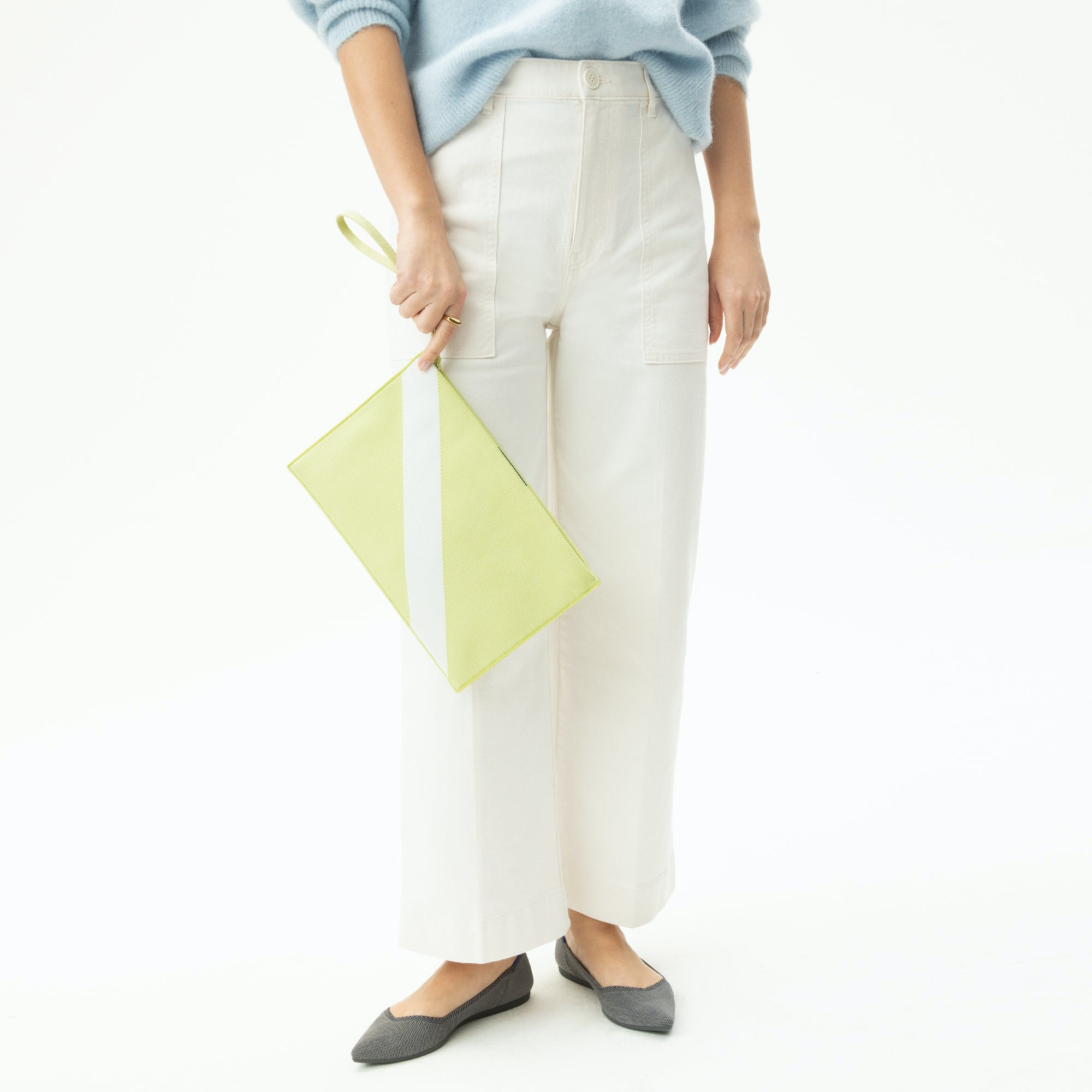 The Essential Pouch in Light Lime shown from the front.