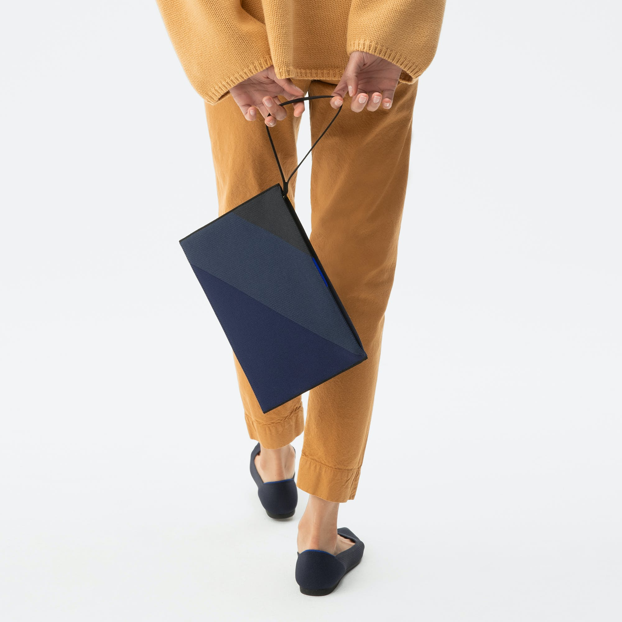 The Essential Pouch in Midnight Navy shown from the front.