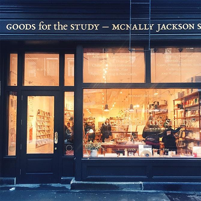 Lit up store view of McNally Jackson.