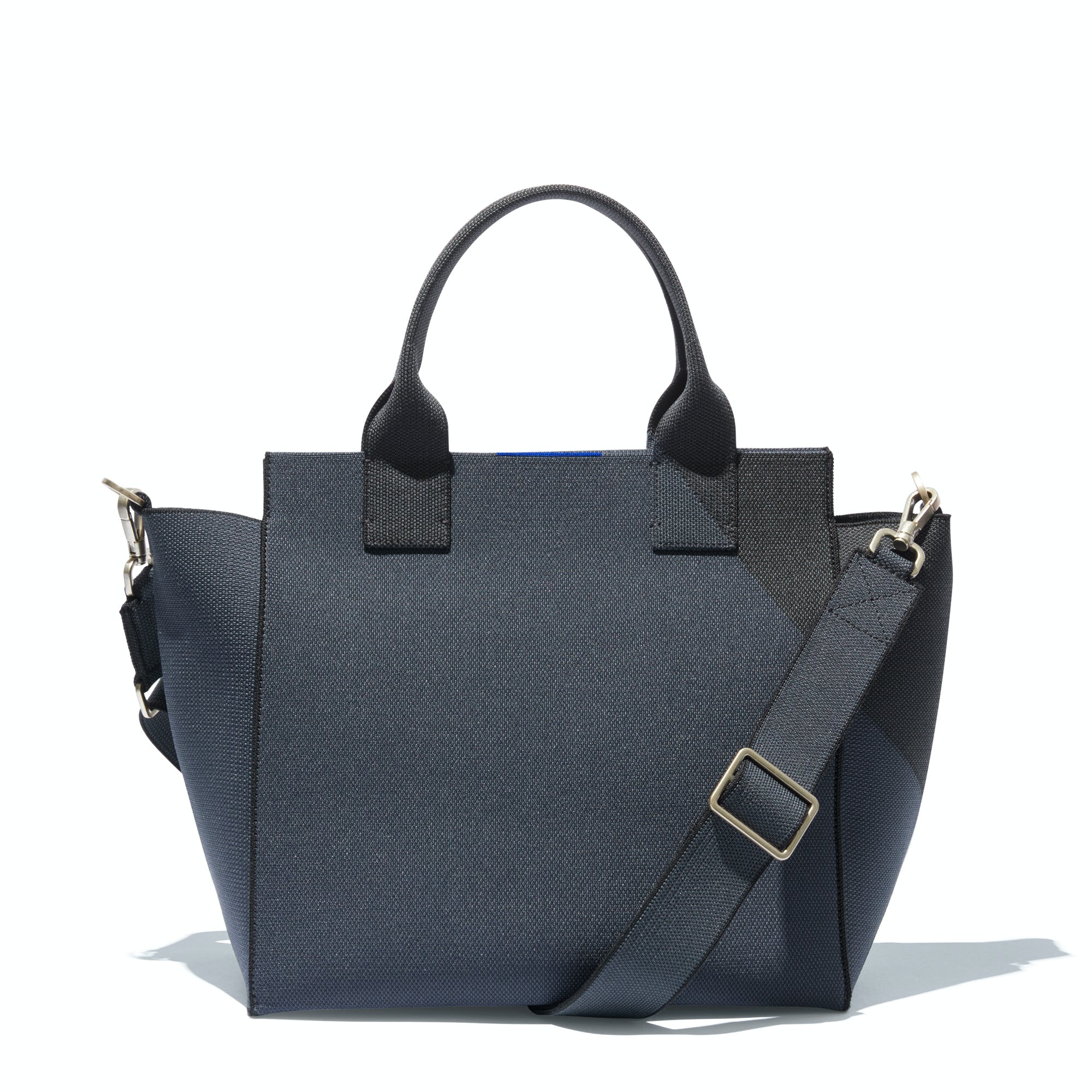 The Handbag in Midnight Navy shown from the front.