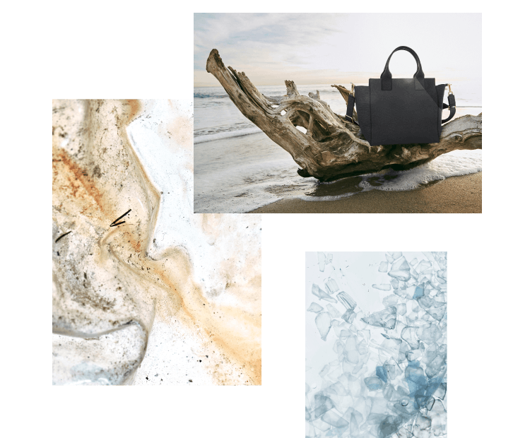 The Handbag in Midnight Navy shown on the beach with marine plastic material in different stages.