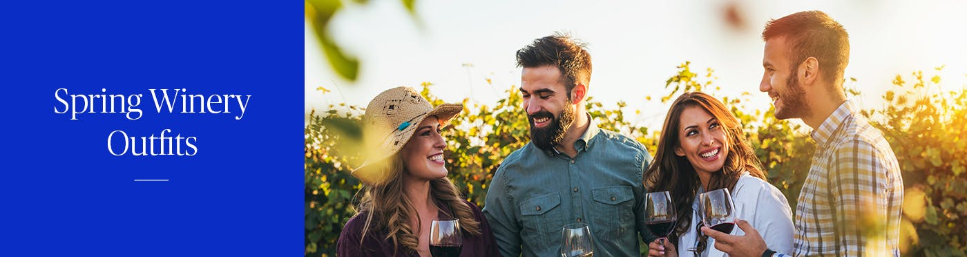 Two couples visiting a winery together during the spring time