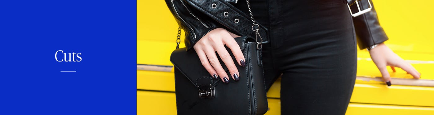 Woman wearing all black outfit paired with a black leathered purse