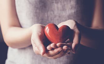 person holding heart in hands