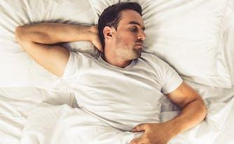 person sleeping on back on latex mattress