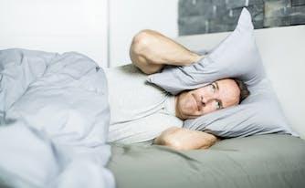 person sleeping with tinnitus