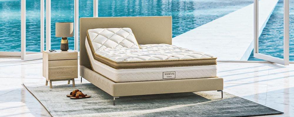 saatva adjustable mattress inside with ocean outside window
