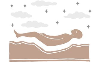 person lying on mattress with body impressions