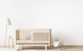 baby nursery with crib in the corner