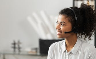 customer service representative with headset on smiling