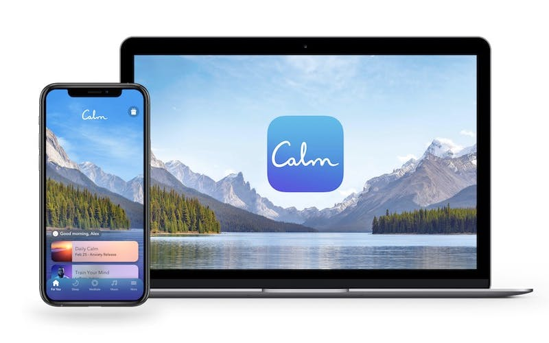 calm app for meditation shown on laptop and phone screens